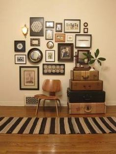 Mixed media displays look instantly cool. Collect old frames and incorporate art in with photos as well as any other nick knacks you like... sconces, keys, etc.