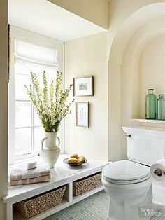 Bathroom storage is essential. Here, a built-in bench in a small alcove adds extra storage, without obstructing the natural light the windows offer. http://www.bhg.com/bathroom/remodeling/planning/bath-details/?socsrc=bhgpin032015cleverbathroomstorage&page=6