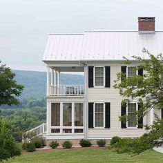 JBM ARCHITECT. This ground-up New England house enjoys a long valley view. The three-season porch and the second-floor open veranda provide al fresco spaces for savoring the magnificent landscape. #classicalarchitecture #newengland #classicism #porch #classical #traditionalarchitecture #veranda #traditional #architecturelovers #classicdesign #architecturaldetail #countryhome #archidaily #greenery #archilovers #instaarchitecture #architecturedesign #architecture #design #beautifulbuildings…