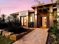 Concrete modern house exterior with french doors & landscaped garden - House Facade photo 217472