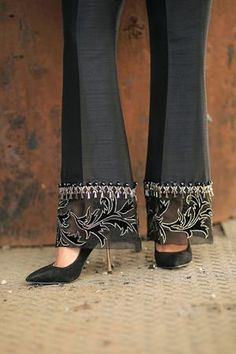 Black raw silk trousers with velvet and organza patchwork on flare with embellishment. Can be ordered as cigarette trousers, straight trousers, bootcut trousers or culottes. Suit Fashion, Fashion Pants, Fashion Dresses, Pakistani Fashion Party Wear, Mehndi Fashion, Sleeves Designs For Dresses, Salwar Designs, Stylish Dresses For Girls, Dress Sewing Patterns