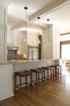 Lisa Mallory Interior Design of Memphis, TN - open galley kitchen design. Cabinets to ceiling, pendants, lots of stools