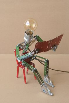A reading lamp.  Dutch artist @Billy Leliveld uses Meccano sets to create delightful lamps.