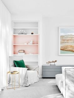 Showcase prized items in a built-in bookcase by painting select shelves a contrasting color.