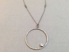 Handmade Hammered Sterling Circle with offset bezel CZ Necklace  by J&I Jewelry