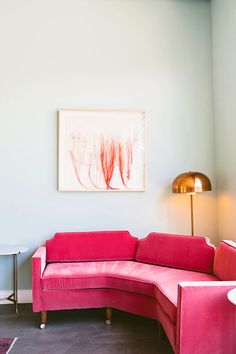 inviting pink curved sofa