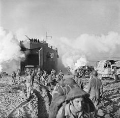 Operation Avalanche, 9 September 1943: British troops and vehicles from 128 Brigade, 46th Division are unloaded from LST 383 onto the beaches of Salerno, Italy - See more at: http://ww2today.com/#sthash.AnpAeH29.dpuf