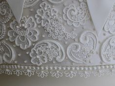 Some of the most beautiful royal icing piping I have ever seen on a cake....or anything, for that matter.