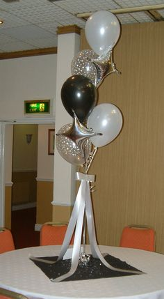 black tie party ideas | We used silver diamond, black, white and clear star latex balloons to ...