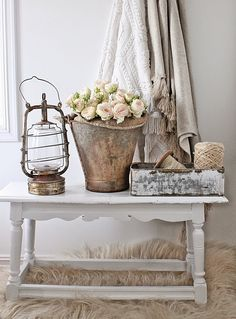 Soft roses in a vintage rustic bucket.