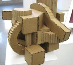Cardboard sculpture for art 1 Cubist Sculpture, Cardboard Sculpture, Cardboard Crafts, Cardboard Houses, Paper Sculptures, Cardboard Relief, Architecture Model Making, Cubist Architecture, Cardboard Model