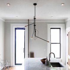 Really like these lights from Another Country & can't remember if I've seen them before: Bent Chandelier