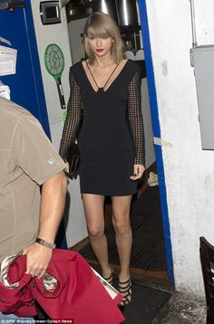 All dressed up: Taylor Swift showed off her slender pins in a LBD as she left a friend's birthday dinner at Los Angeles' Little Door restaurant on Monday night