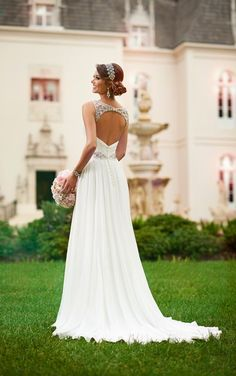 Classic and ethereal, this chiffon Grecian-style  wedding gown from the Stella York collection takes beachside romance to the next level. Featuring fine Diamante detailing along the shoulder straps, waist, and head-turning keyhole back, this gown will set a new standard for seaside nuptials