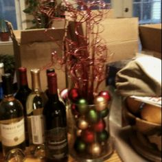 Christmas Centerpiece: vase with Christmas bulbs and glittery twirly twigs in coordinating color