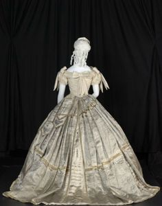 """The Press"" Fancy Dress Gown, 1866  Worn by Mrs. Matilda Butters at the Mayor's Fancy Dress Ball on 20 September 1866, again 14 days later at the Return Fancy Dress Ball 4 October 1866 and 23 December 1867. Made by Mrs. Dobbs."