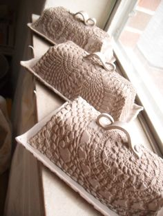 Vintage doily rolled into clay for texture, slab built covered dishes... Good for slab built vessels of all sorts