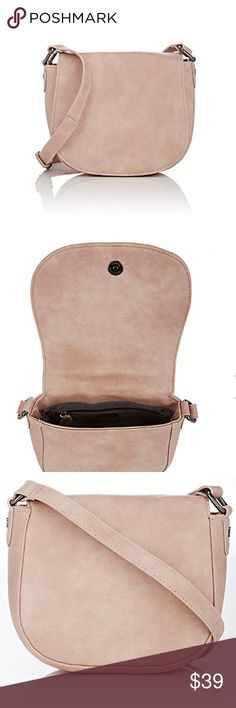 """NWT Delux Lux Patina Mini Saddle Bag, Pink Never been used. Comes from a smoke free home.  Deux Lux's Patina mini saddle bag is constructed of pink distressed-look faux leather. Has a Front flap. Polished gunmetal-tone hardware. It is Lined with grey silky twill. Zip pocket at interior. Adjustable flat faux-leather strap 21 to 24 inch strap drop. Magnetic snap closure. 6.5"""" height x 7.5"""" width x 3.0"""" depth Barneys New York Bags Crossbody Bags"""