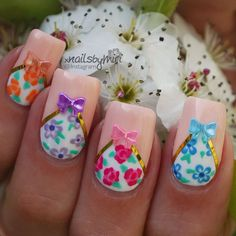 Floral nail polish in bows and French tips. Who says you can never have too much of everything? This French tip, bow and floral nail art ensemble is just perfect for each other.