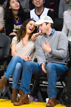Mila Kunis and Ashton Kutcher attend a basketball game between the Oklahoma City Thunder and the Los Angeles Lakers at Staples Center.