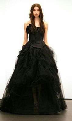 IF I get married I'm almost certain it will be in a black wedding dress. And blood red bridesmaids. :) Call me a weirdo. I love it.