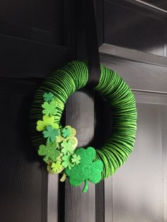 Yarn wrapped wreath embellished for St. Patrick's Day