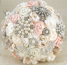 brooch bouquet - lovely with cream and peach, diamonds and pearls.
