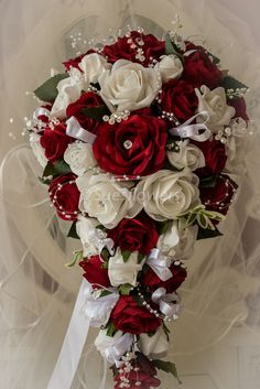 Wedding flowers brides teardrop bouquet in white and red - All About Cascading Wedding Bouquets, Vintage Wedding Flowers, Red Bouquet Wedding, Cascade Bouquet, Bride Flowers, White Wedding Flowers, Bride Bouquets, Wedding White, Red Rose Wedding