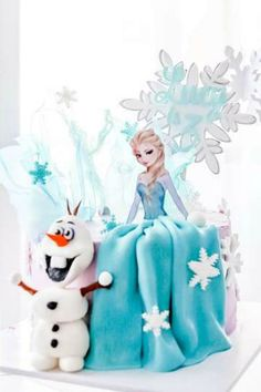 Feast your eyes on this spectacular Frozen birthday party! The cake is stunning!  See more party ideas and share yours at CatchMyParty.com #catchmyparty #partyideas #frozen #frozenparty #princessparty #girlbirthdayparty #frozencake #elsa
