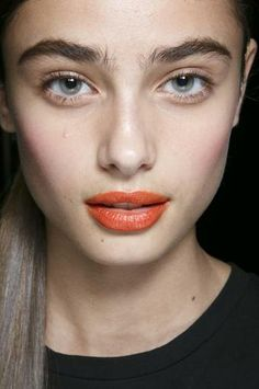 At DKNY, orange lipstick was all anyone could talk about. Makeup artist Charlotte Willer created this citrusy lip backstage using Maybelline ColorSensational Vivids Lip Color in Neon Red.