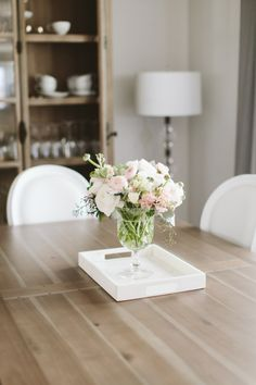 Fresh blooms: http://www.stylemepretty.com/living/2016/04/25/peek-inside-a-bloggers-glamorous-home-re-vamp/ | Photography: Angela Cox - http://www.angelacoxphotography.com/