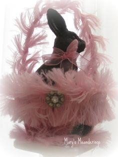 Pink feather Easter basket to go with your pink feather Easter tree with a delicious chocolate bunny to munch on.