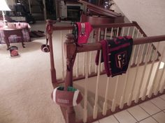 football sweaters on stair rail