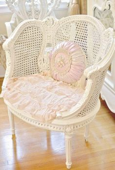 White shabby chic chair with pink pillow