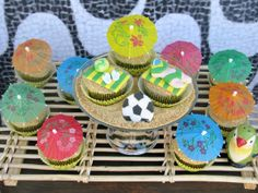 Lynlee's Colorful Rio Party! We love these creative cupcake toppers!