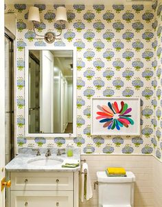 Who knew a bold printed wallpaper could simply transform a powder room into a playful and contemporary space? Here's a tip - when using a bold wallpaper or a dramatic wall color, don't over decorate. Let the walls do all the talking!