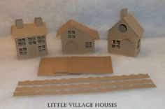 Little Village Cardboard Christmas Houses- SET OF 3 HOUSES with Flicker Light Holes- Putz Style Houses. $18.00, via Etsy.