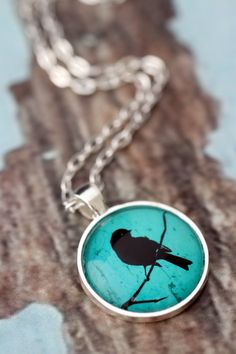 Turquoise Bird Silhouette - silver or bronze pendant necklace. Teal green jewellery. by KitschyKooDesign on Etsy https://www.etsy.com/listing/127181420/turquoise-bird-silhouette-silver-or