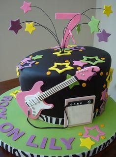 Pop Star theme.  Topsy Turvy design, Fondarific black fondant.  I handmade Guitar and Amp in gumpaste and ...