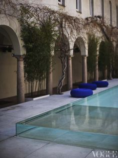 Glass pool in Franciscan Monastery, poofs Paola Lenti