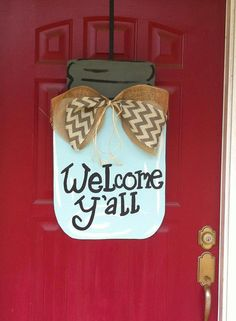 Welcome southern hospitality with this super cute Welcome Yall Mason Jar door hanger! Measuring 27 1/2 long and 17 wide this hand painted, wooden