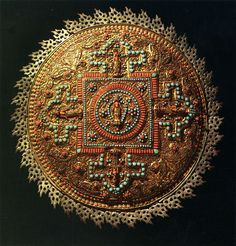 Mandala from Nepal. 20th century. Brass, with coral and turquoise inlays and filigree work. The Museum of Oriental Art, Moscow