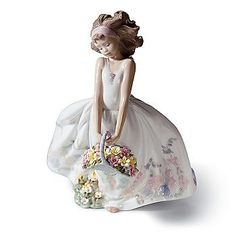 Lladro. GRS says: I just love this, with all the little flowers on the dress and in the basket. Fabulous.
