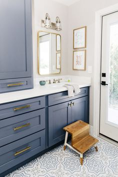 blue cabinets in bathroom with pattern tile