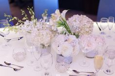All white centerpieces    www.facebook.com/NaturalSimplicityFlowers