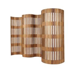 Separate your space with this natural wooden divider. It's a raw ornamental piece that successfully creates new vistas in your home. The small openings in the wood give the divider an airy feel while allowing for added privacy.