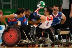 The USA's Chuck Aoki (C) is stopped by three French players during their qualifying wheelchair rugby match for the Paralympic Games in Rio de Janeiro, Brazil on September 14, 2016. / AFP / CHRISTOPHE SIMON