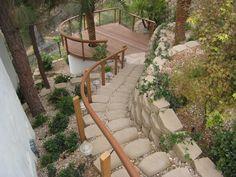 stone walkway onto a hillside deck. Sweet.