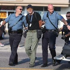 Ah those First Amendment rights.   GettyImages snap own photographer Scott Olson being arrested in #Ferguson, MO. pic.twitter.com/nxQgdhlMRG