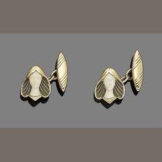 A pair of art nouveau plique-à-jour enamel and ivory cufflinks,